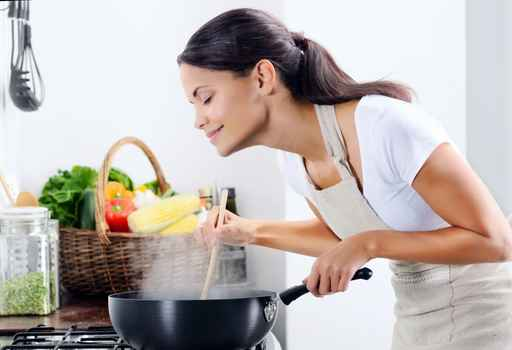 Mix race woman cooking in the kitchen