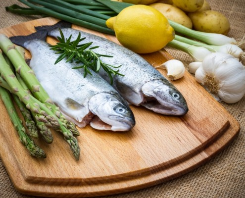 Raw trout with green asparagus, lemon and ingredients