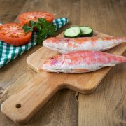 Fresh red mullet with tomatoes and parsley